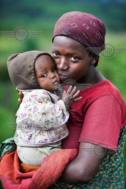 A woman kisses her baby.