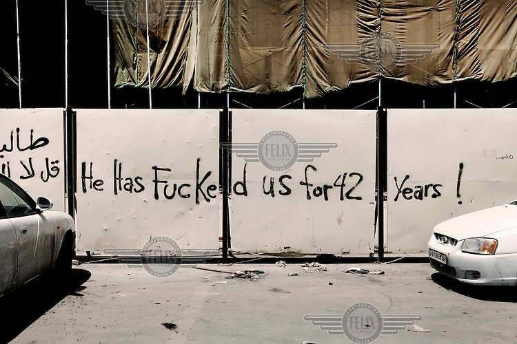Graffiti on a wall in Benghazi reads: 'He has fucked us for 42 years!'. On 17 February 2011 Libya saw the beginnings of a revolution against the 41 year regime of Col Muammar Gaddafi..