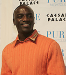 Billboards after party at Pure in Caesars Palace<br /> hip hop artist Akon (orange shirt)