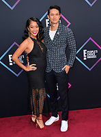 LOS ANGELES, CA. November 11, 2018: Harry Shum Jr. &amp; Shelby Rabara at the E! People's Choice Awards 2018 at Barker Hangar, Santa Monica Airport.<br /> Picture: Paul Smith/Featureflash
