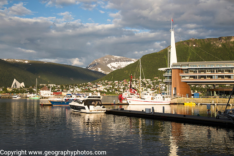 Modern architecture of Scandic Hotel and boats in harbour, city centre of Tromso, Norway