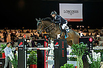 Denis Lynch of Ireland riding Querida in action during the Longines Speed Challenge competition as part of the Longines Hong Kong Masters on 13 February 2015, at the Asia World Expo, outskirts Hong Kong, China. Photo by Li Man Yuen / Power Sport Images