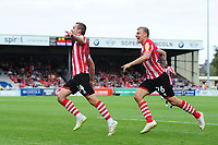 Lincoln City's Harry Toffolo, left, celebrates scoring his sides third goal with team-mate Harry Anderson<br /> <br /> Photographer Chris Vaughan/CameraSport<br /> <br /> The EFL Sky Bet League Two - Lincoln City v Swindon Town - Saturday 11th August 2018 - Sincil Bank - Lincoln<br /> <br /> World Copyright &copy; 2018 CameraSport. All rights reserved. 43 Linden Ave. Countesthorpe. Leicester. England. LE8 5PG - Tel: +44 (0) 116 277 4147 - admin@camerasport.com - www.camerasport.com