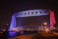 """""""Aerial Lift Bridge in Red, White, & Blue""""<br /> Duluth's Aerial Lift Bridge was decked out in red, white, and blue for Duluth's Independence Day celebrations. The Aerial Lift Bridge is one of the most-recognized iconic landmarks of Duluth. In a mere 55 seconds, the bridge rises to 138 feet, making it the quickest and biggest lift bridge in the world."""