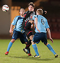 Pars' Josh Falkingham gets between Forfar's James Dale and Gary Fusco.