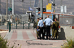 Israeli security forces gather at the site where a Palestinian woman attempted to stab an Israeli border police with a knife before being shot dead, near the Tapuah junction, also known as the Zaatara junction, south of the city of Nablus in the Israeli occupied West Bank, on October 19, 2016. A police statement said the 19-year-old approached officers at the Tapuah junction, ignored orders to stop and pulled a knife. Photo by Nedal Eshtayah