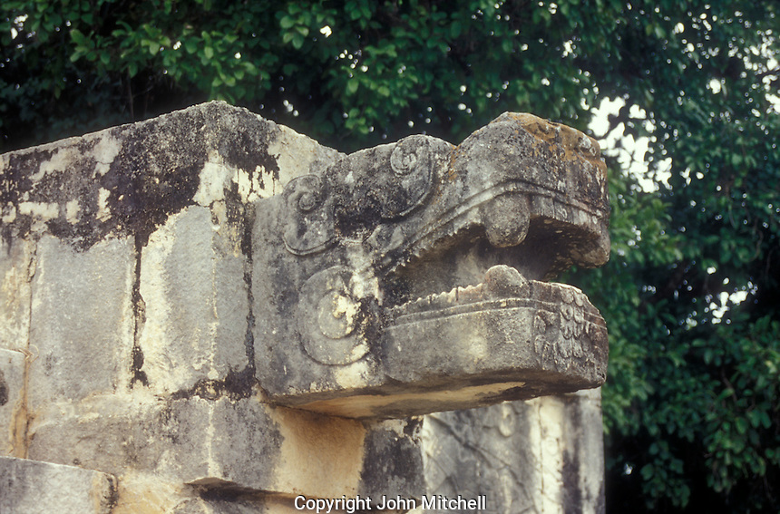 Serpent head stone carving at the Mayan ruins of Chichen Itza, Yucatan, Mexico