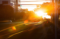 The sun rises on downtown Austin as thousands of commuters travel to state offices in downtown during morning rush-hour traffic.