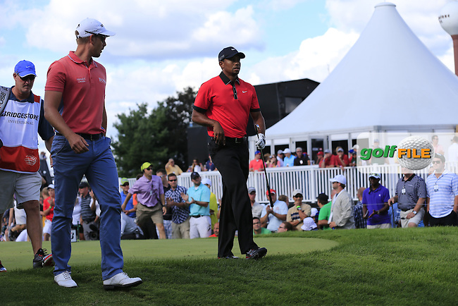 Henrik Stenson (SWE) and Tiger Woods (USA) walk off the 17th tee during Sunday's Final Round of the 2013 Bridgestone Invitational WGC tournament held at the Firestone Country Club, Akron, Ohio. 4th August 2013.<br /> Picture: Eoin Clarke www.golffile.ie