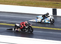 Mar 16, 2014; Gainesville, FL, USA; NHRA pro stock motorcycle rider Matt Smith (near lane) races alongside Jerry Savoie during the Gatornationals at Gainesville Raceway Mandatory Credit: Mark J. Rebilas-USA TODAY Sports