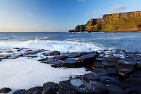 Waves splashing over basalt columns near sunset, Giant's Causeway, County Antrim, Northern Ireland, United Kingdon