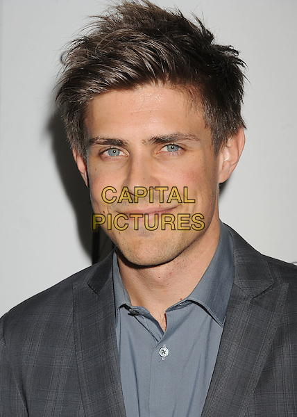 Chris Lowell.W Magazine's 69th Annual Golden Globe Awards Celebration held at The Chateau Marmont, West Hollywood, California, USA..13th January 2012.headshot portrait grey gray blue .CAP/ROT/TM.©Tony Michaels/Roth Stock/Capital Pictures