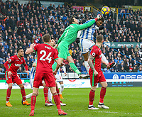 Swansea City's Lukasz Fabianski beats Huddersfield Town's Steve Mounie to a cross<br /> <br /> Photographer Alex Dodd/CameraSport<br /> <br /> The Premier League - Huddersfield Town v Swansea City - Saturday 10th March 2018 - John Smith's Stadium - Huddersfield<br /> <br /> World Copyright &copy; 2018 CameraSport. All rights reserved. 43 Linden Ave. Countesthorpe. Leicester. England. LE8 5PG - Tel: +44 (0) 116 277 4147 - admin@camerasport.com - www.camerasport.com