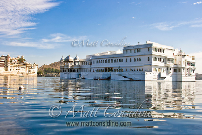 The famous Taj Lake Palace built with white marble, floating in the middle of Lake Pichola - a blend of serenity and opulence.<br /> (Photo by Matt Considine - Images of Asia Collection)