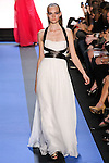 Nimue walks runway in a chalk white chiffon gown with black leather banded bodice, by Monique Lhuillier, from the Monique Lhuillier Spring 2012 collection fashion show, during Mercedes-Benz Fashion Week Spring 2012.