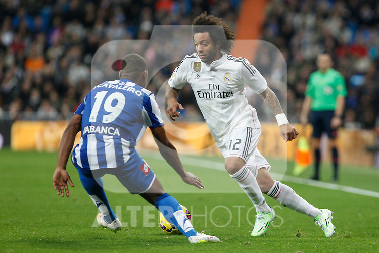 Real Madrid´s Marcelo Vieira (R) and Deportivo de la Courna´s Cavaleiro during La Liga match at Santiago Bernabeu stadium in Madrid, Spain. February 14, 2015. (ALTERPHOTOS/Victor Blanco)
