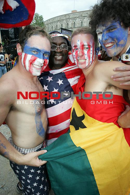 FIFA WM 2006 -  Fan Meile Nuernberg<br /> <br /> <br /> <br /> USA - Ghana<br /> <br /> <br /> <br /> Ghana und USA Fans feiern zusammen nach dem Spiel.<br /> <br /> USA Fan mit Ghanaflagge<br /> <br /> <br /> <br /> Foto: nordphoto