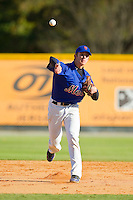 Eli White (5) of Wren High School makes a throw to first base during fielding practice at the 2012 South Atlantic Border Battle on November 3, 2012 in Burlington, North Carolina.  The Mets (SC13) defeated the Red Sox (NC 13) 3-2.  (Brian Westerholt/Four Seam Images)