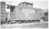 RGS caboose #0401 in Ridgway yard.<br /> RGS  Ridgway, CO  Taken by Richardson, Robert W. - 5/24/1951