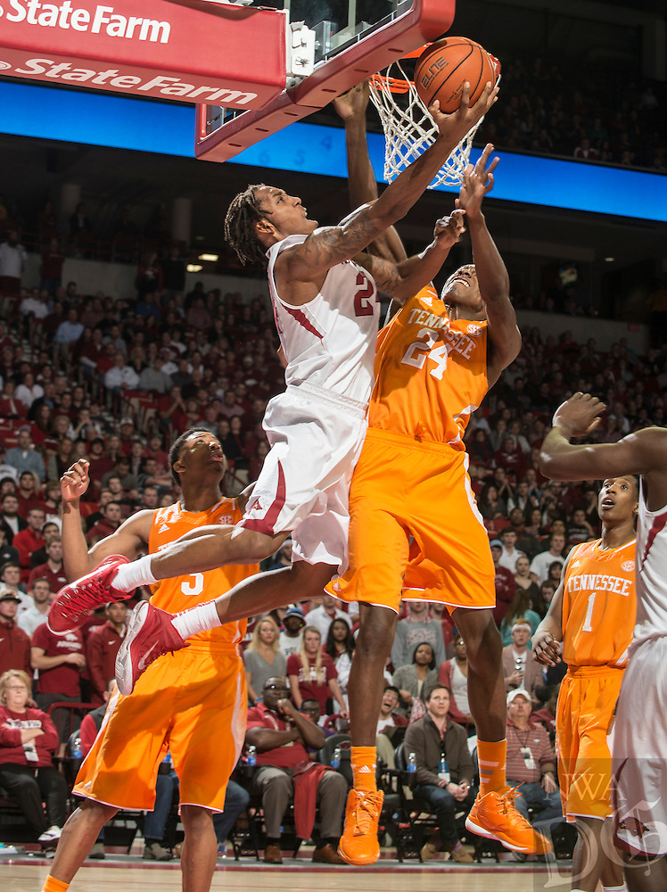 NWA Democrat-Gazette/ANTHONY REYES • @NWATONYR<br /> Michael Qualls, Arkansas junior, shoots as Willie Carmichael, Tennessee freshman, defends in the second half Tuesday, Jan. 27, 2015 at Bud Walton Arena in Fayetteville. The Razorbacks won 69-64.