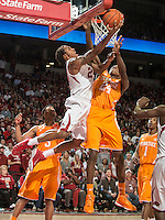 NWA Democrat-Gazette/ANTHONY REYES &bull; @NWATONYR<br /> Michael Qualls, Arkansas junior, shoots as Willie Carmichael, Tennessee freshman, defends in the second half Tuesday, Jan. 27, 2015 at Bud Walton Arena in Fayetteville. The Razorbacks won 69-64.