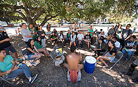 The Occidental College Hawaii Club welcomes guest speaker Daniel Anthony, a taro farmer from the island of Oahu, as he teaches about making Hawaiian pai ʻai and poi and Hawaiian culture, Tuesday, November 5, 2013 in the Academic Quad. Daniel Anthony demonstrated how to pound the Hawaiian food staple taro using the same methods that have been used by the Hawaiians for thousands of years by hand pounding the taro on wooden boards (papa kuʻi ʻai) using stone pounders (pōhaku kuʻi ʻai). Hawaiian activist Daniel Anthony is a farm-to-table kalo farmer with multiple taro fields located on the island of Oʻahu. With his business Mana ʻAi, Daniel has been advocating the benefits of eating kalo because of its high nutrition content and because it is dairy, soy, gluten, and GMO free, finding ways to get kalo back into homes across the state as well as popular restaurants and eateries. (Photo by Marc Campos, Occidental College Photographer)
