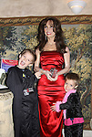 All My Children's Susan Lucci (wax figure at Madame Tussauds) poses with Kameron and sister Stephanie at Kids Night on Broadway at Madame Tussauds, NYC, NY. (Photo by Sue Coflin/Max Photos)