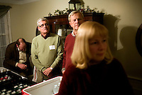 People listen to former Utah governor Jon Huntsman speak at a house party in Bedford, New Hampshire, on Jan. 8, 2012. Huntsman is seeking the 2012 Republican presidential nomination.