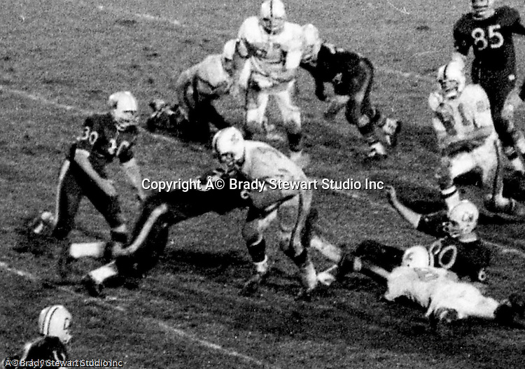 Bethel Park PA:  Offensive play with Clark Miller 30 taking an inside handoff after a good block by Gary Biro 81.  Others in the photo; Mike Stewart 11, Bob Hensler 77.  Clark was a punishing runner, good blocker and had good speed.  The offense and defense played very well in the  14-0 victory over Canon McMillan. .  The defensive unit was one of the best in Bethel Park history only allowing a little over 7 points a game.