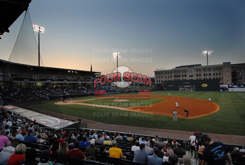 The lights are on as the sun goes down during a South Atlantic League game between the Greenville Drive and Rome Braves on April 13, 2010, at Fluor Field at the West End in Greenville, S.C. Photo by: Tom Priddy/Four Seam Images