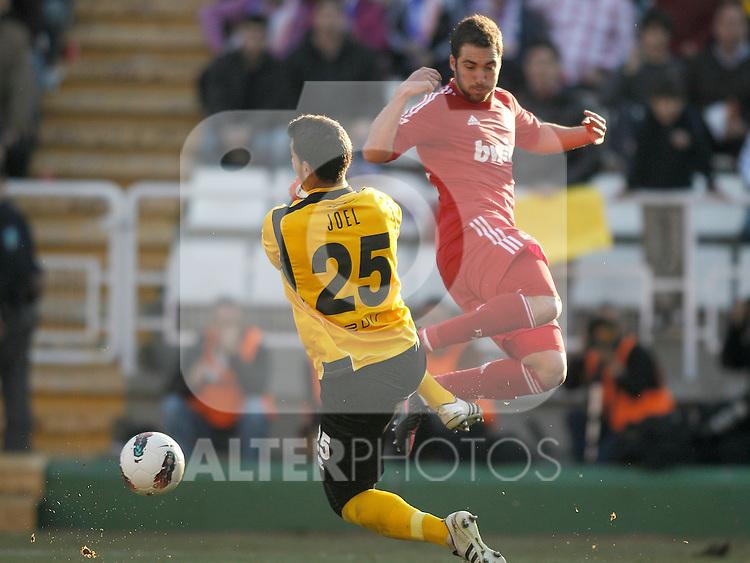 Rayo Vallecano's Joel against Real Madrid's Gonzalo Higuain during La Liga Match. February 26, 2012. (ALTERPHOTOS/Alvaro Hernandez)