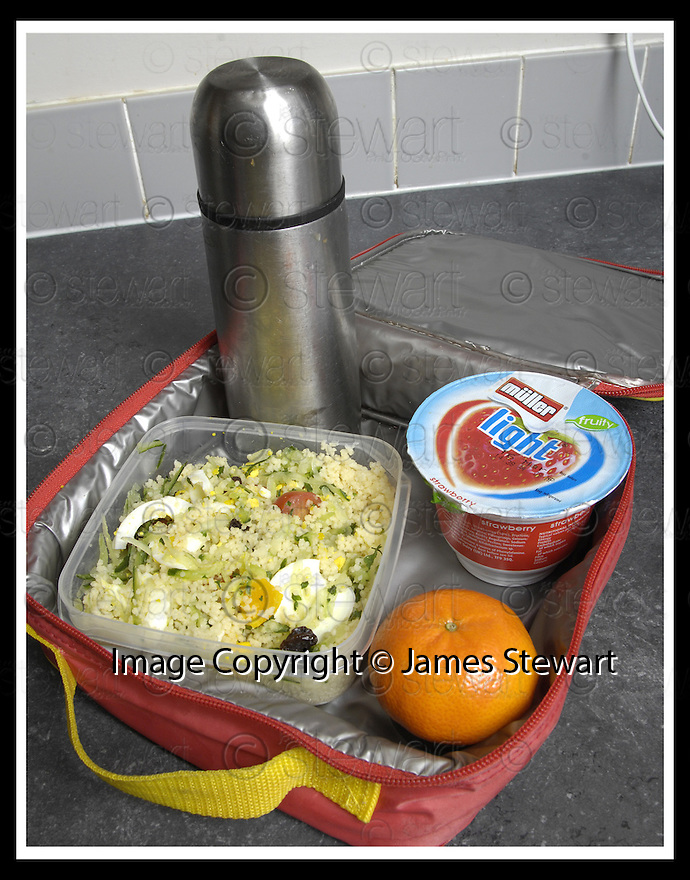 13/03/2007       Copyright Pic: James Stewart.File Name : sct_jspa06_lunch.THE SCHOOL LUNCH BOX AS PER THE NEW GOVERNMENT GUIDELINES.... FLASK OF CARROT SOUP, COUSCOUS CUCUMBER EGG TOMATO AND RAISIN SALAD, YOGHURT AND A SATSUMA....James Stewart Photo Agency 19 Carronlea Drive, Falkirk. FK2 8DN      Vat Reg No. 607 6932 25.Office     : +44 (0)1324 570906     .Mobile   : +44 (0)7721 416997.Fax         : +44 (0)1324 570906.E-mail  :  jim@jspa.co.uk.If you require further information then contact Jim Stewart on any of the numbers above.........