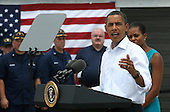 United States President Barack Obama with his  wife Michelle speaks at a Coast Guard base in Panama City, Florida USA on Saturday, 14 August  2010.  The First Family visiting the area to help promote tourism and check on clean up efforts concerning the aftermath of the Deepwater Horizon Oil Spil. .Credit: Dan Anderson / Pool via CNP