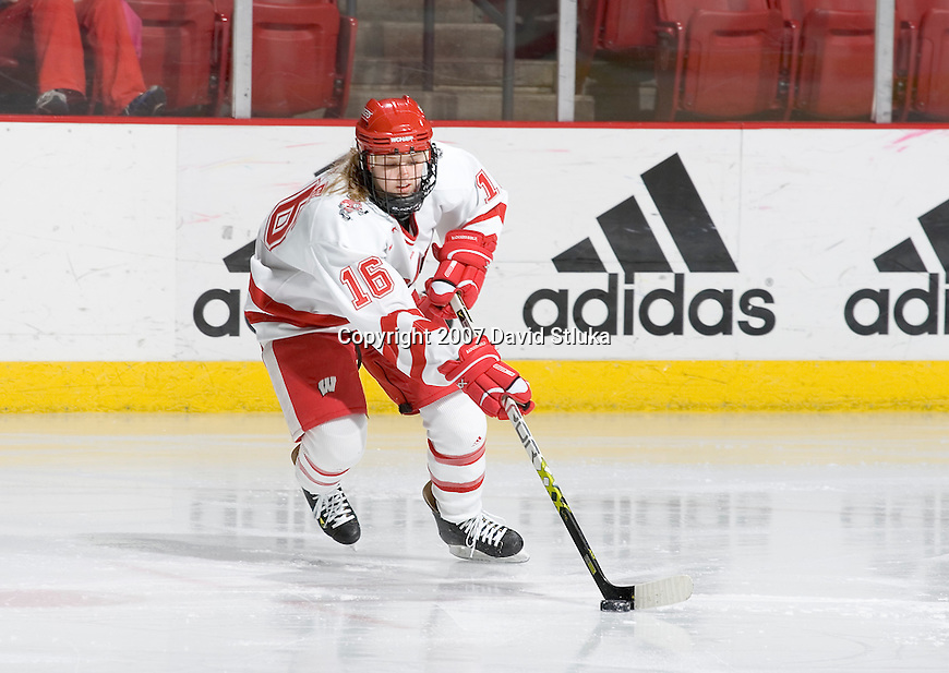 MADISON, WI - FEBRUARY 16: Rachel Bible #16 of the Wisconsin Badgers women's hockey team handles the puck against the Bemidji State Beavers at the Kohl Center on February 16, 2007 in Madison, Wisconsin. The Badgers beat the Beavers 2-0. (Photo by David Stluka)