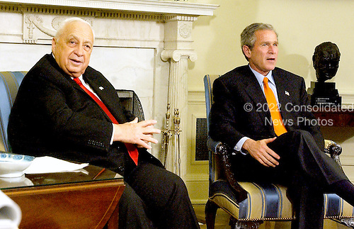 Prime Minister Ariel Sharon of Israel, left, and United States President George W. Bush, right, conduct a joint press conference with in the Oval Office in the White House in Washington, D.C. on May 7, 2002 following their talks.<br /> Credit: Ron Sachs / CNP