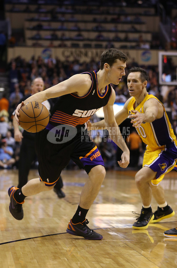 Jan. 30, 2013; Phoenix, AZ, USA: Phoenix Suns guard Goran Dragic (1) against Los Angeles Lakers guard Steve Nash (10) at the US Airways Center. Mandatory Credit: Mark J. Rebilas-