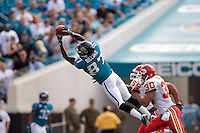 November 08, 2009:     Jacksonville Jaguars wide receiver Jarett Dillard (87) goes up high for a first down catch during first half action between the AFC West  Kansas City Chiefs and AFC South Jacksonville Jaguars at Jacksonville Municipal Stadium in Jacksonville, Florida............