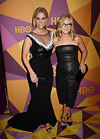 BEVERLY HILLS, CA - JANUARY 07: Actors Cheryl Hines (L) and Rachael Harris arrive at HBO's Official Golden Globe Awards After Party at Circa 55 Restaurant in the Beverly Hilton Hotel on January 7, 2018 in Los Angeles, California.