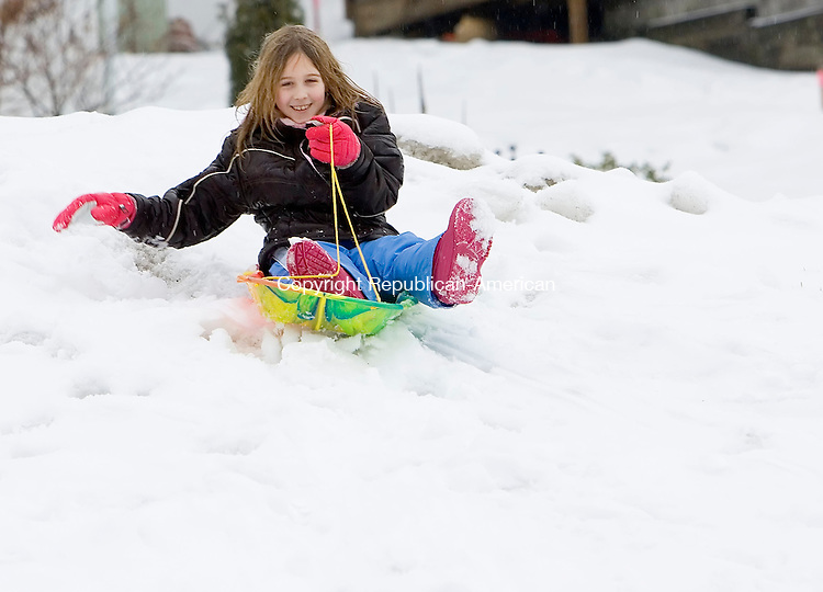 WATERBURY, CT- 01 JAN 2008- 010108JT05-<br /> Mariah Dumaine, 9,  sleds down a hill at Sanford Avenue Field with her friend Alyssa Voigt, also 9, not pictured, in Thomaston on Tuesday, New Year's Day.<br /> Josalee Thrift / Republican-American