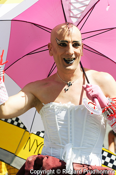 a male participating in the Pride parade in Montreal