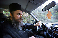 Mount Athos - The Holy Mountain.<br /> Father Theophilos drives his car to the capital Karyes.