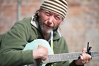 NWA Democrat-Gazette/CHARLIE KAIJO Mark Prime of Rogers strums his guitar, Monday, March 26, 2018 in Downtown Rogers in Rogers . <br />