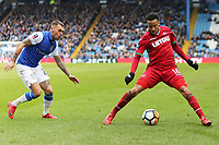Martin Olsson of Swansea City (R) controls the ball while marked by Jack Hunt of Sheffield Wednesday (L) during The Emirates FA Cup Fifth Round match between Sheffield Wednesday and Swansea City at Hillsborough, Sheffield, England, UK. Saturday 17 February 2018