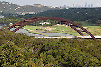 The Pennybacker 360 bridge on the Colorado River in Austin Texas on a bright summer's day.