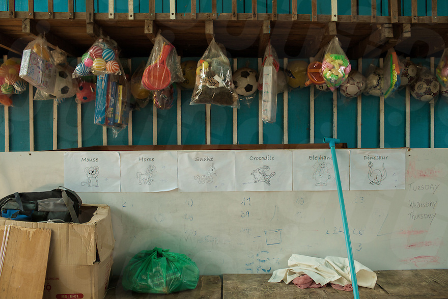 04/04/2013 - Siem Reap (Cambodia). Bags full of toys donated by tourists are hung on a wall of an orphanage in the outskirt of Siem Reap. In many organizations, the best way to keep donations going on, is to keep the children at a substandard level in order to show donants how critical their help is to the orphanage. © Thomas Cristofoletti 2013