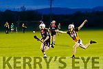 Colin Walsh, Ballyheigue, gets away from Abbeydorneys Shane Donovan when the sides met  in the Credit Union sponsored Minor League Division 1A Final last Friday night in Abbeydorney.