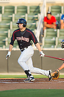 Jacob Morris (24) of the Kannapolis Intimidators follows through on his swing against the Hickory Crawdads at CMC-Northeast Stadium on May 19, 2014 in Kannapolis, North Carolina.  The Crawdads defeated the Intimidators 10-6.  (Brian Westerholt/Four Seam Images)