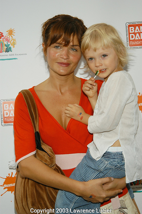 "NEW YORK - SEPTEMBER 20: Model Helena Christensen and her child appear September 20, 2003 at the Elizabeth Glazer Pediatric AIDS Foundation ""Kids for Kids"" Celebrity Carnival in New York City."