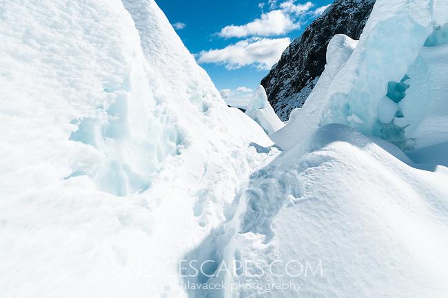 Hiking among ice blocks on Franz Josef Glacier in winter, Westland Tai Poutini National Park, West Coast, UNESCO World Heritage Area, New Zealand, NZ