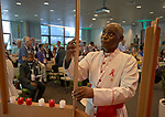"""The Rev. Canon Gideon Byamugisha, a founder of the International Network of Religious Leaders Living with or Personally Affected by HIV or AIDS (INERELA+), helps build a symbolic bridge during the July 21 opening session of """"Faith Building Bridges"""" in Amsterdam, the Netherlands. The July 21-22 interfaith event, sponsored by the World Council of Churches-Ecumenical Advocacy Alliance, was held on the eve of the 2018 International AIDS Conference."""